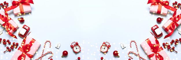 Merry christmas and happy holidays greeting card or banner with christmas gifts