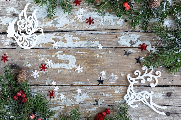 Merry christmas and happy holidays greeting card, frame, banner. new year. happy new year card with snow on wooden background. winter xmas holiday theme. flat lay. copy space