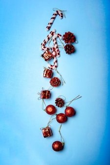 Merry christmas and happy new year on blue background. christmas balls and candy cane