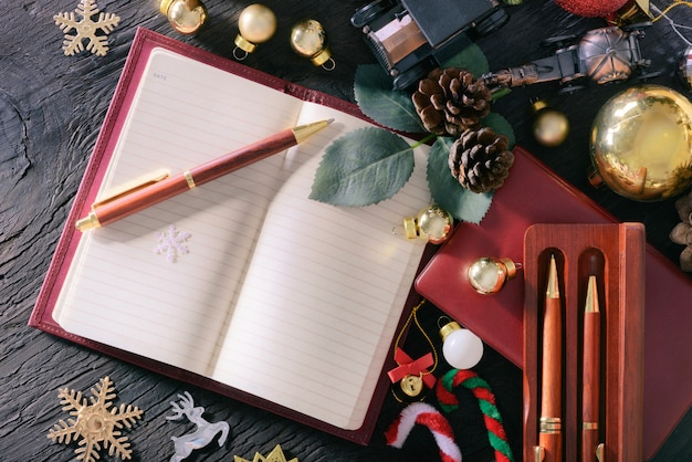 Merry christmas and happy new year concept with book note vintage pen wood and other decoration