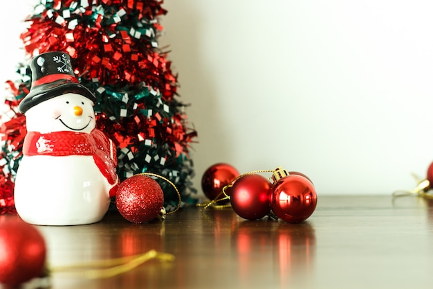 Merry christmas and happy new year  decoration with snow doll on wood floor.