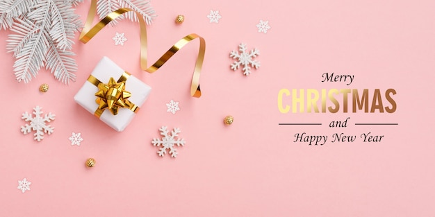Merry christmas and happy new year greeting card with gift box and decoration