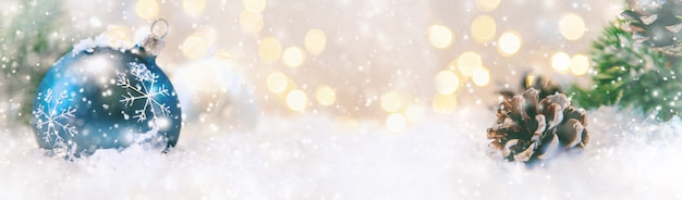 Merry christmas and happy new year, holidays greeting card with blurred bokeh background.