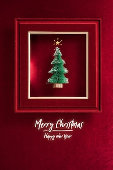 Merry christmas and happy new year text and christmas tree in felt photo frame on velvet red felt fabric