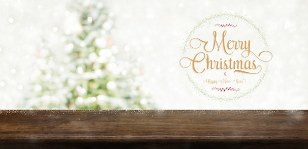 Merry christmas and happy new year wreath glitter over wood table at blur bokeh christmas