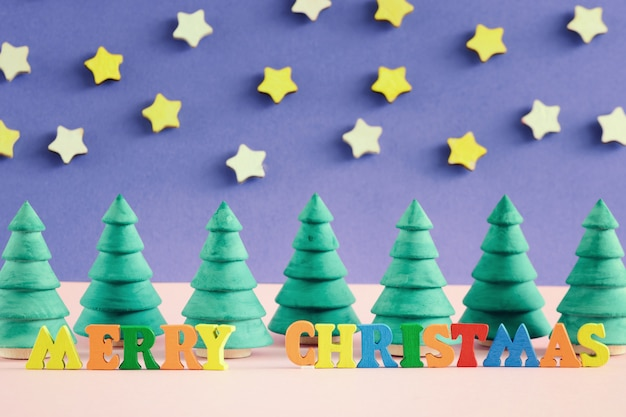 Merry christmas inscription  in colorful letters.
