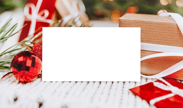 Merry christmas and merry new year concept with gift boxes and greeting card with background