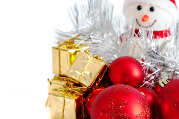 Merry christmas, new year, snowman, gifts in gold boxes and red balls