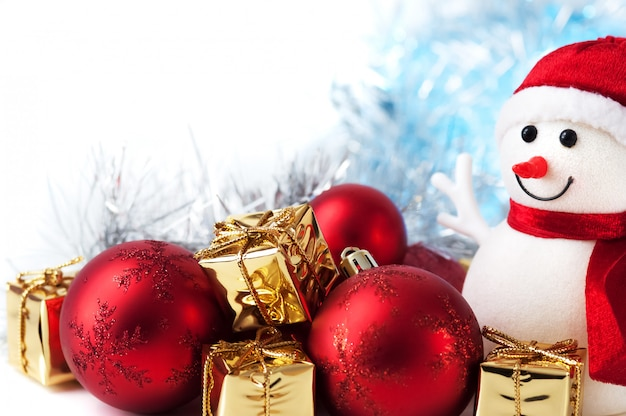 Merry christmas, new year, snowman, gifts in golden boxes and red balls