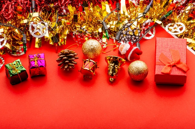 Merry christmas red background with gold and shiny decorative elements