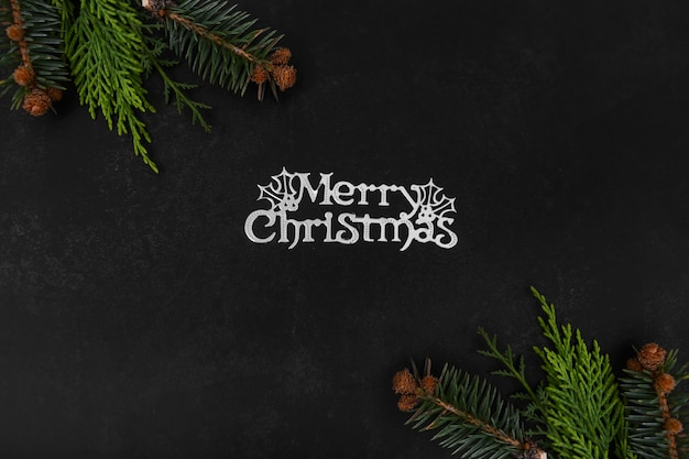 Merry christmas text with decoration, top view