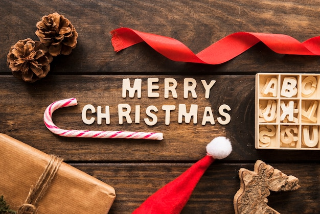 Merry christmas title near present box, snags and letters in case