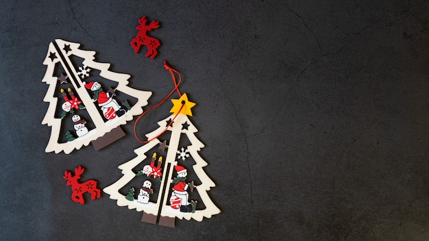 Merry christmas tree toys on a black background.