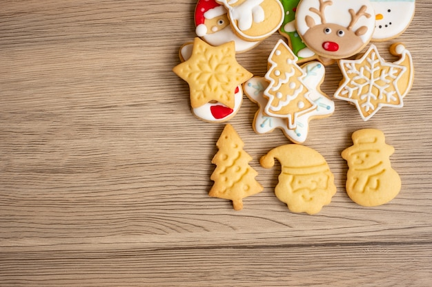 Merry christmas with homemade cookies on wood table background. xmas, party, holiday and happy new year concept