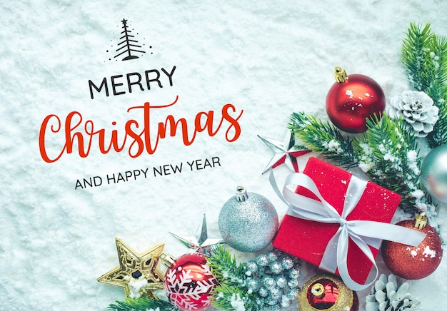 Merry christmas with ornament on snow backgroundfor christmas concepts or new yearcelebration ideast