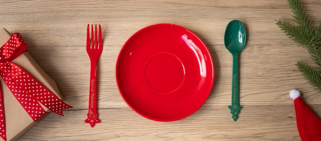 Merry christmas with plate, fork and spoon on wood table background. xmas, party and happy new year concept