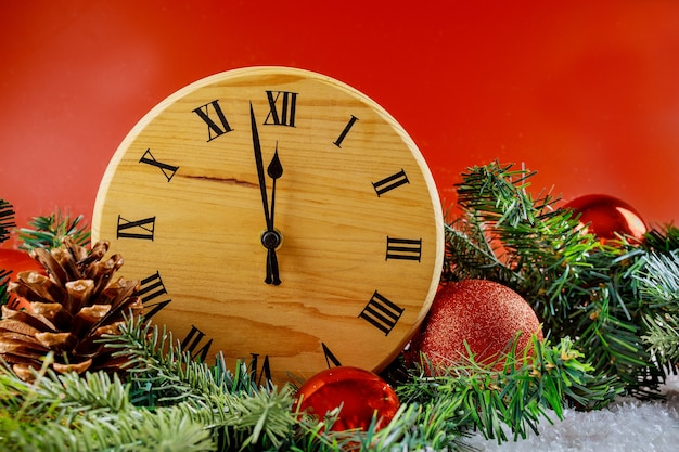 Merry new year happy holidays winter decorative clock fir tree with snow