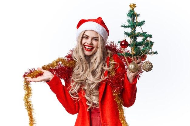 陽気な女性のクリスマスの休日の装飾の明るい背景