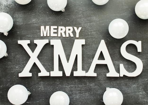 Merry xmas inscription with shiny baubles