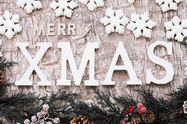 Merry xmas inscription with snowflakes