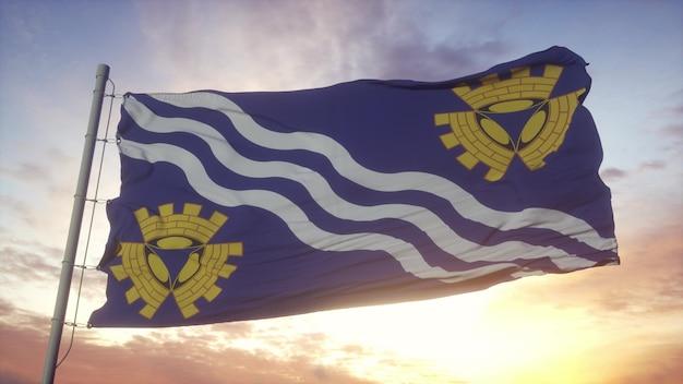 マージーサイドの旗、イギリス、風、空、太陽の背景に手を振っています。 3dレンダリング。