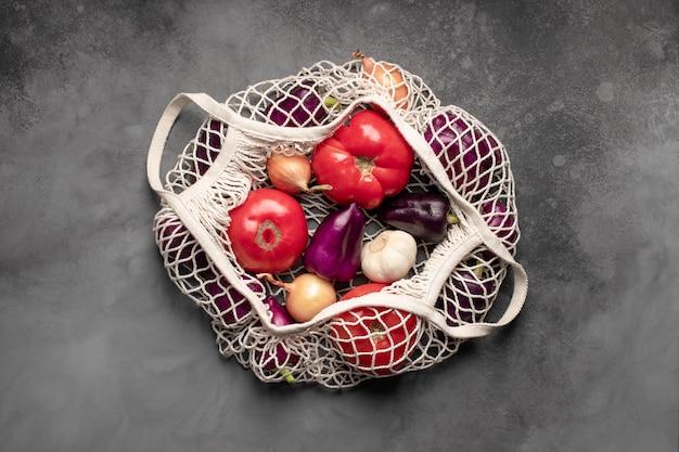 Mesh bag with fresh vegetables.