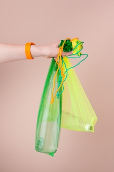 Mesh bags with reusable glass water bottle
