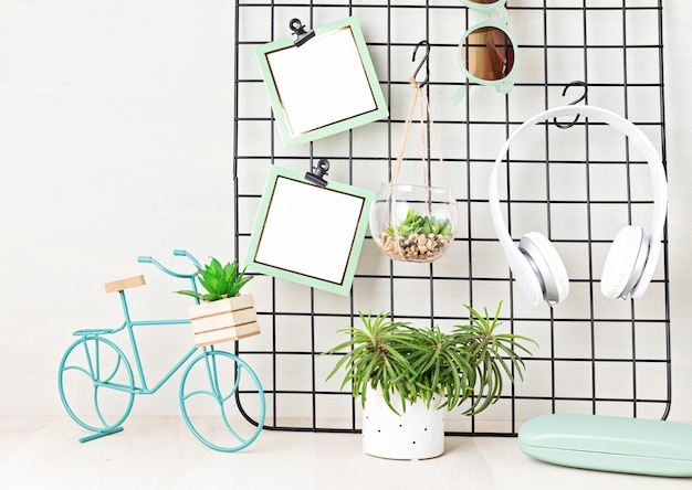 Mesh board with cards, eyeglasses, house plants. stay home, home organisation, decoration, planning, slow living concept.