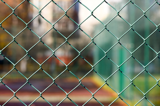 Mesh fence. green metal fence made of welded mesh. close up