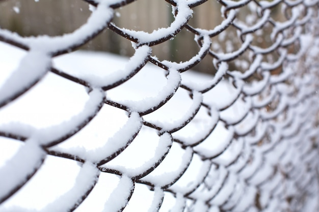 Mesh fence lattice crushed by snow.