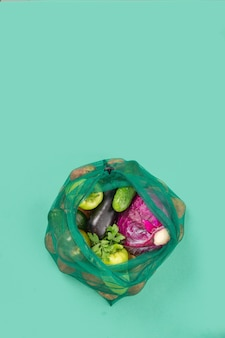 Mesh grocery bags of assorted vegetables