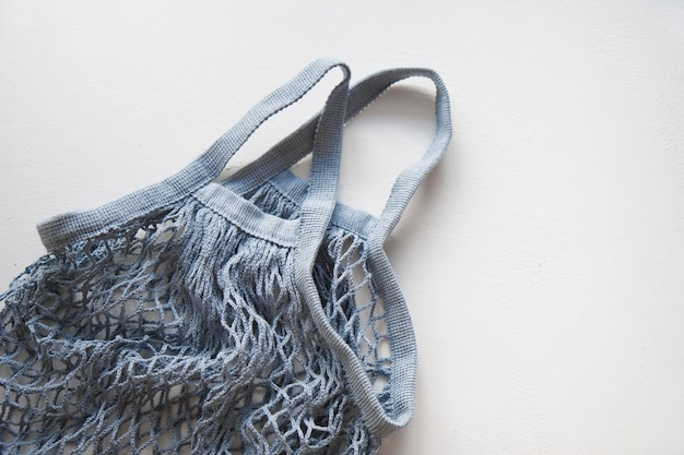 Mesh knitted eco shopping bags on light surface