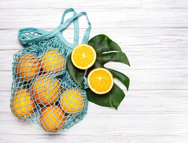 Mesh shopping bag with oranges
