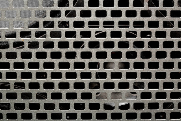 Mesh steel texture of the musical instrument. black amplifier audio speaker
