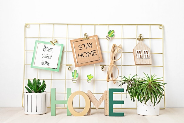 Meshboard with cards, eyeglasses, house plants. stay home, home organisation, decoration, planning, slow living concept.