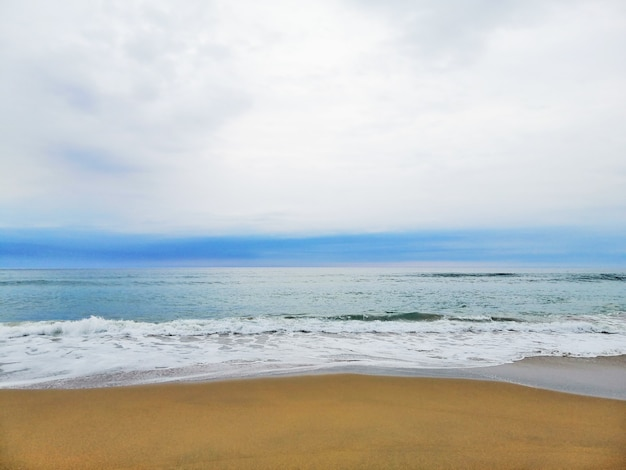 Mesmerizing sunrise over the sandy beach in san sebastian resort town, spain