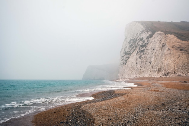 Mesmerizing view of the calm ocean on a foggy day in purbeck heritage coast swanage uk