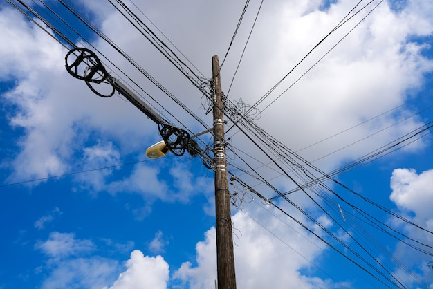 Messy electric aerial wires and pole mexico