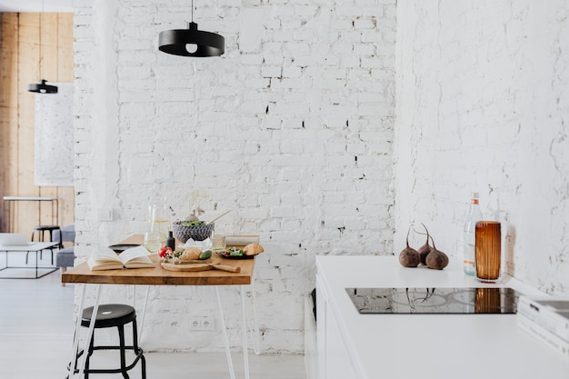 Messy table in a minimal kitchen decor