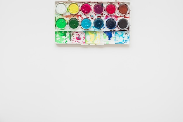 Messy watercolor palette isolated on white background