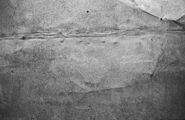 老後の痕跡、鉄の釘の痕跡を伴う金属の背景。