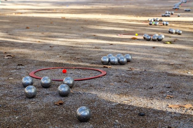 Metal balls for petanque or boules on the ground perspective view popular street game in france