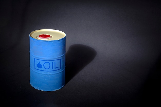 Metal barrel of oil with text oil
