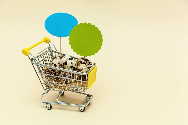 Metal basket with quail eggs on a beige background. food concept. photo with place for your text and design.