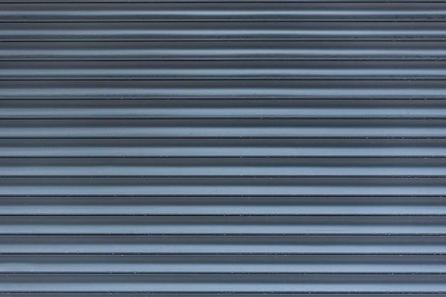 Металлические жалюзи. серый абстрактный космос в линии. свет и тень. текстурированная поверхность