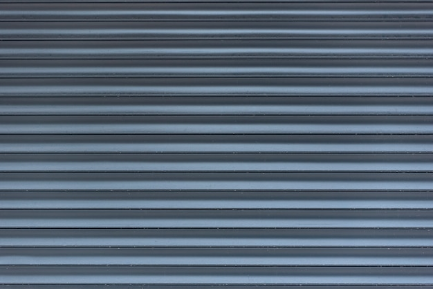 Metal blinds. grey abstract space in line. light and shadow. textured surface