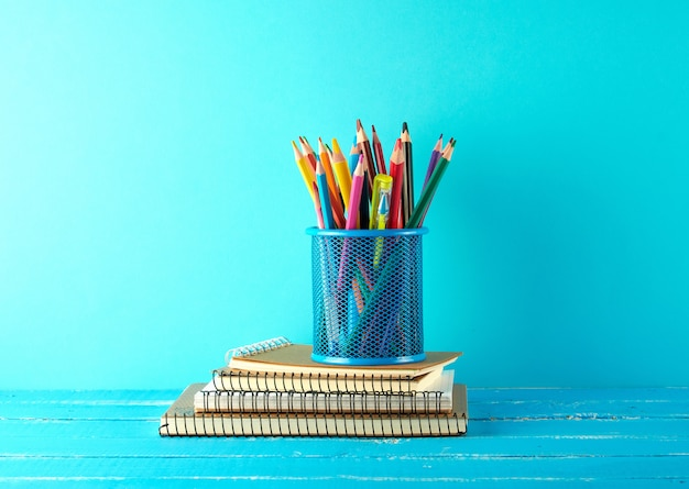 Metal blue stationery stand with multi colored wooden pencils