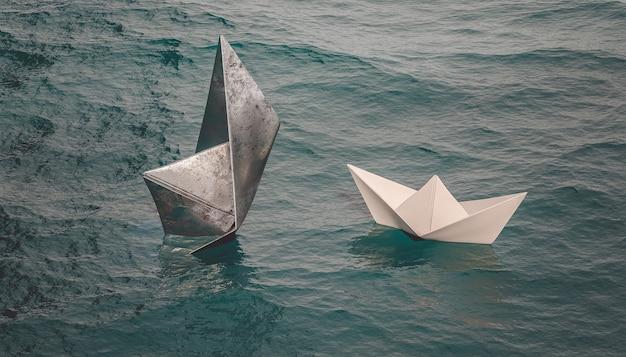 紙の船が水上を航行している間、金属の船は沈みます。 3dレンダリング。