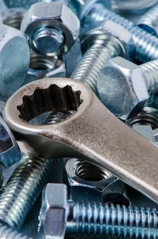 Metal bolts and nuts, tools for working and fixing