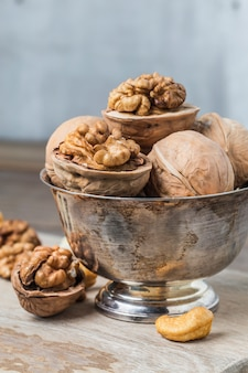 Metal bowl with walnuts